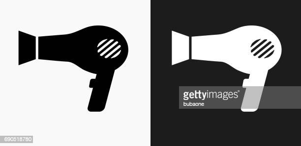 blow dryer icon on black and white vector backgrounds - hair dryer stock illustrations, clip art, cartoons, & icons