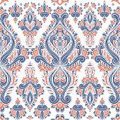 Blue and orange stylized ornamental flower seamless pattern. Vintage, paisley elements.