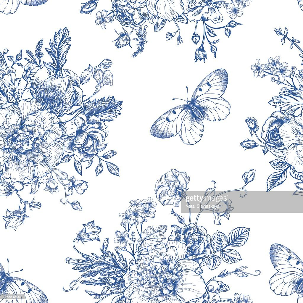 A blue and white pattern of flowers and butterflies