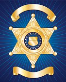 A blue background with a gold police badge