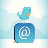 Blue bird perched on blue @ symbol