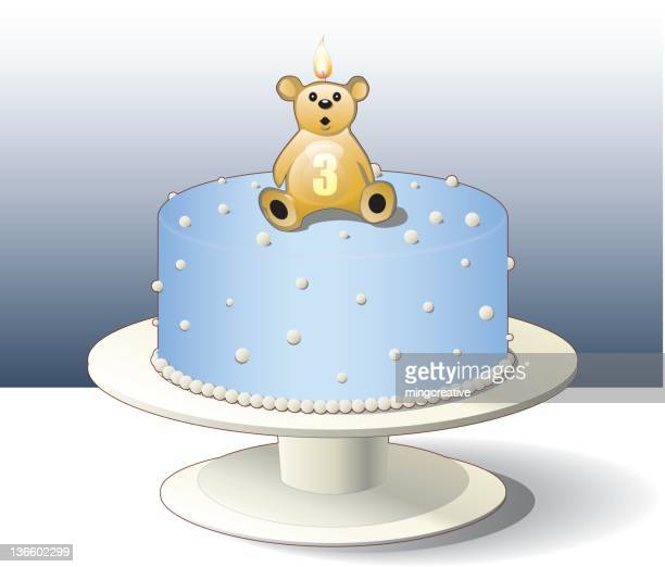 Blue cake with bear candle for 3-years-old