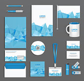 Blue corporate id template  with triangular faces, company style