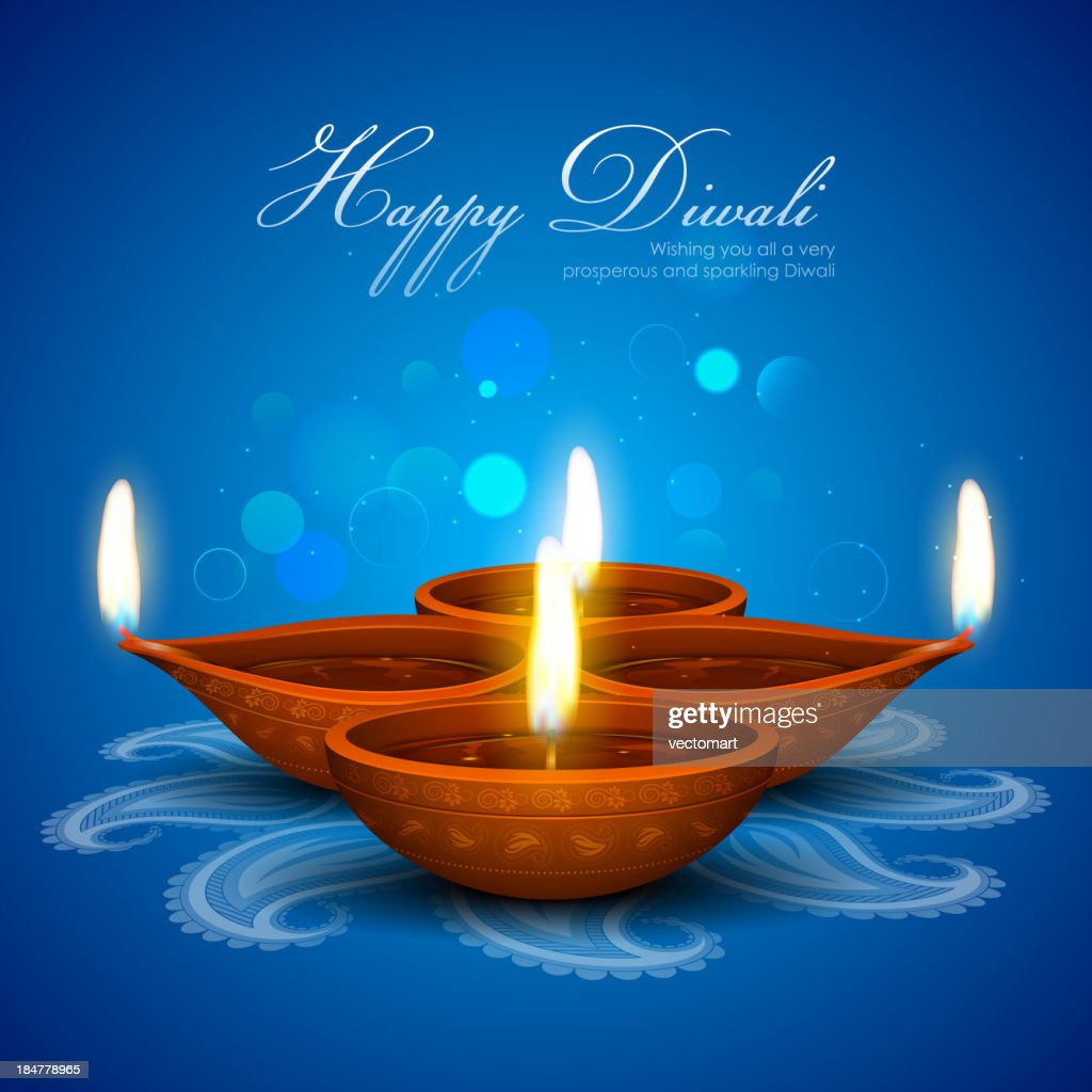 Blue Happy Diwali card containing 4 candles