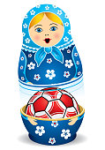 Blue matryoshka opening with a red soccer ball inside it on white background. Matryoshka doll also known as a Russian nesting doll is a set of wooden dolls of decreasing size