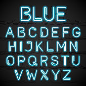 Blue neon light alphabet with cable