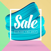 Blue paint brush background and sale in frame isolated on bright colors