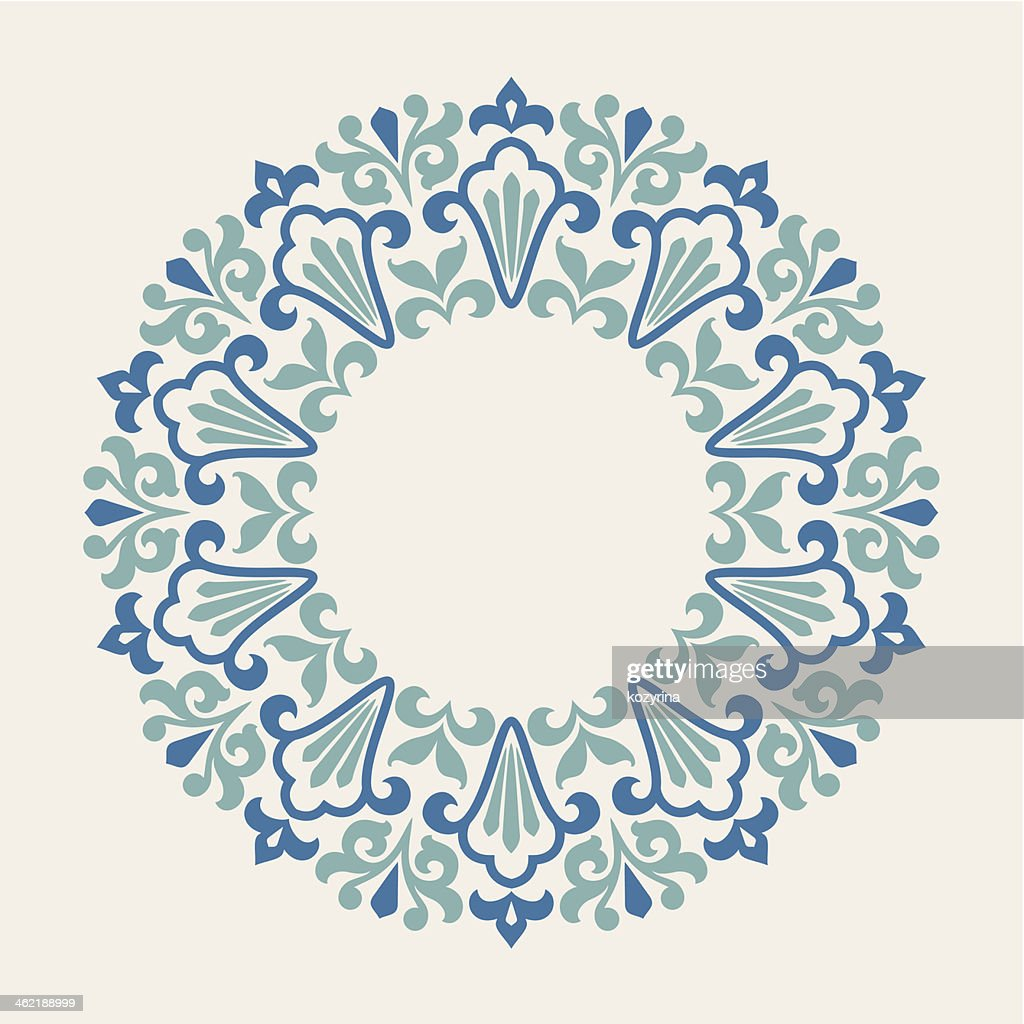 Blue round ornamental pattern against a cream background