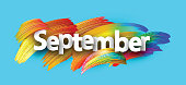 Blue september paper banner with colorful brush strokes.
