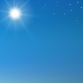 Blue sky background with shining sun and stars