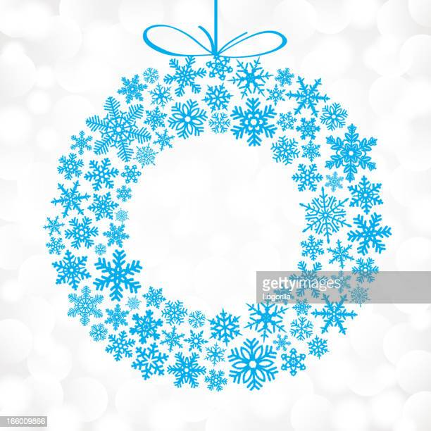blue snowflakes in the shape of a christmas wreath - laurel wreath stock illustrations