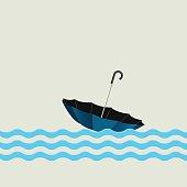 Blue umbrella on waves