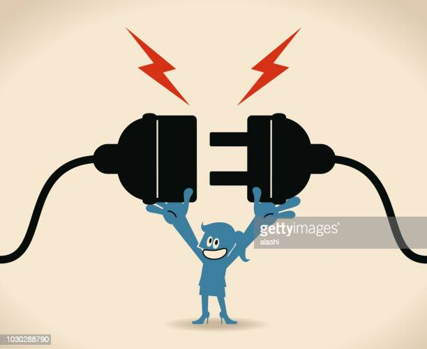 blue woman holding huge wired electrical plug and socket ready to establish connection - electric plug stock illustrations