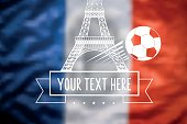 blurred french tricolore flag with eiffel tower and soccer ball