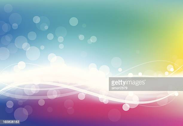 Blurred rainbow background with white dots in the foreground