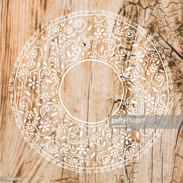 boho frame background with white lace stencil on shabby wood wall. shabby wooden background. grunge texture, painted surface. coastal background. - lace textile stock illustrations