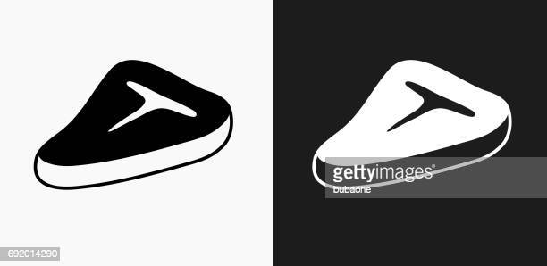 T Bone Steak Icon on Black and White Vector Backgrounds