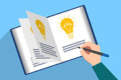 Book with ideas. Writing of new idea