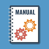 book with manual title and gear cogs