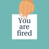 "Boss holds in hand a white sheet with text ""You're fired"""