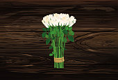 Bouquet of white flowers. Roses tied with a rope. Greeting card for Valentine's Day wedding and birthday. Empty space for your text or advertisement. Vector illustration on a wooden background