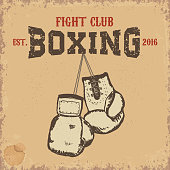 Boxing club. Boxing gloves on grunge background.