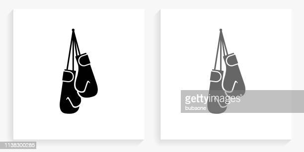 boxing gloves black and white square icon - boxing glove stock illustrations