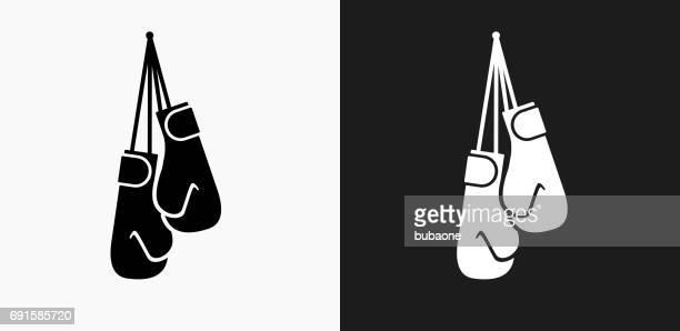 ilustrações de stock, clip art, desenhos animados e ícones de boxing gloves icon on black and white vector backgrounds - luva de boxe