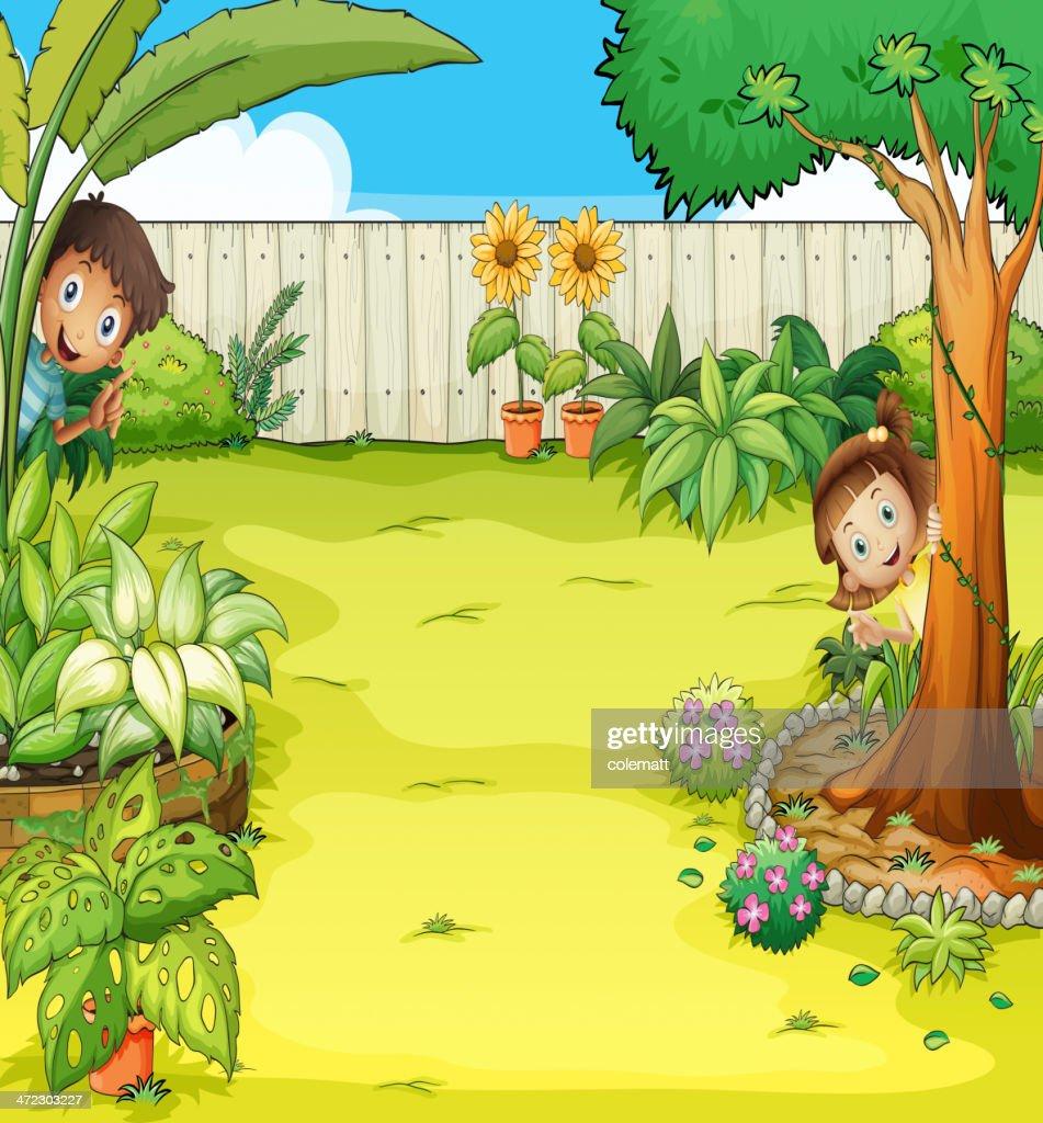 Boy and a girl hiding in the garden