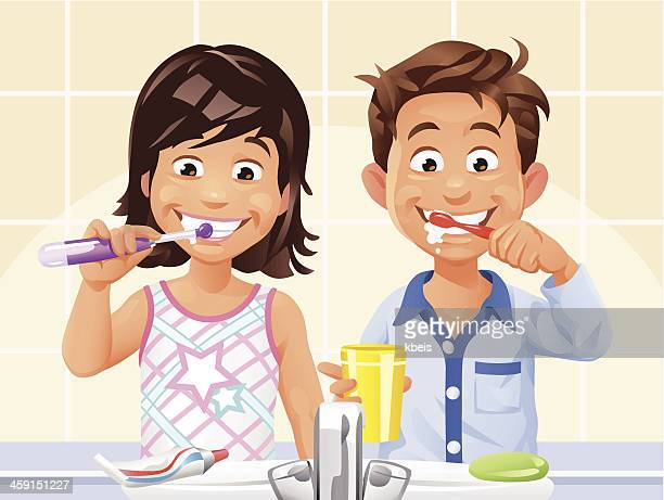 boy and girl brushing teeth - electric toothbrush stock illustrations