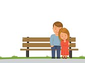 Boy and girl cuddling sitting on a Park bench. Isolated on white background couple sitting on bench. Vector illustration in flat style.