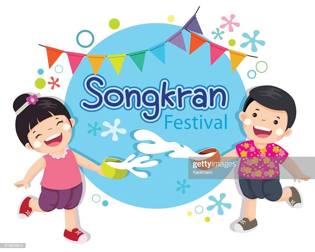 Boy and girl enjoy splashing water in Songkran festival Thailand.