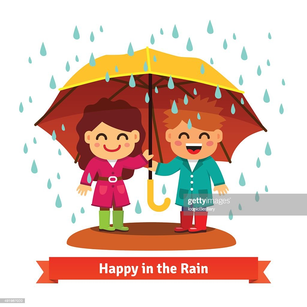 Boy and girl standing in the rain under umbrella