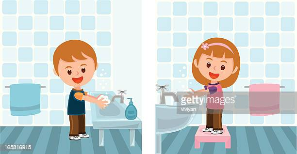 boy and girl washing hands