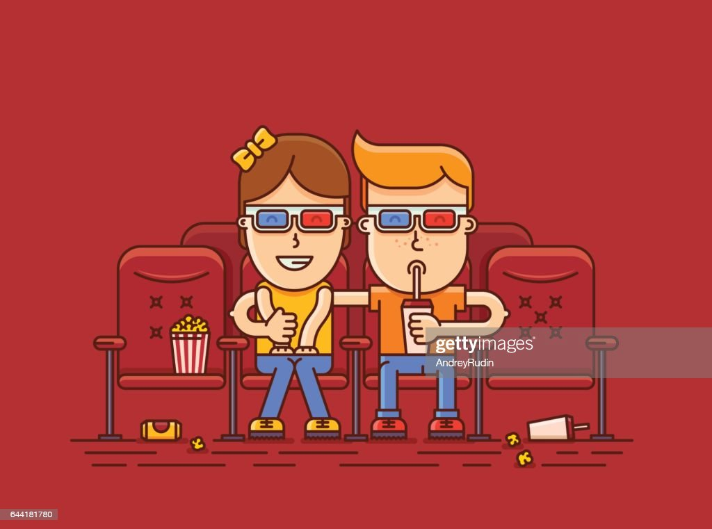 boy and girl watching a movie at the cinema