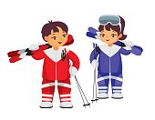 boy and girl with skis