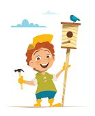 Boy and nesting box with bird