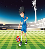 Boy at field using ball with the flag of Norway