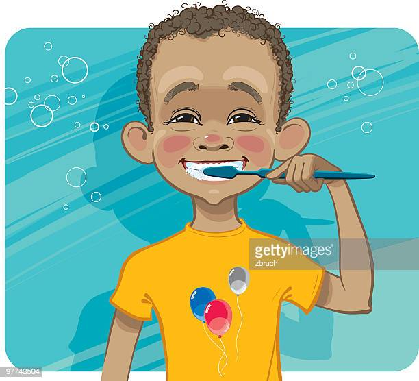 Boy cleaning his teeth.