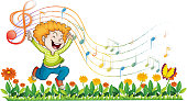 boy dancing in the garden with musical notes