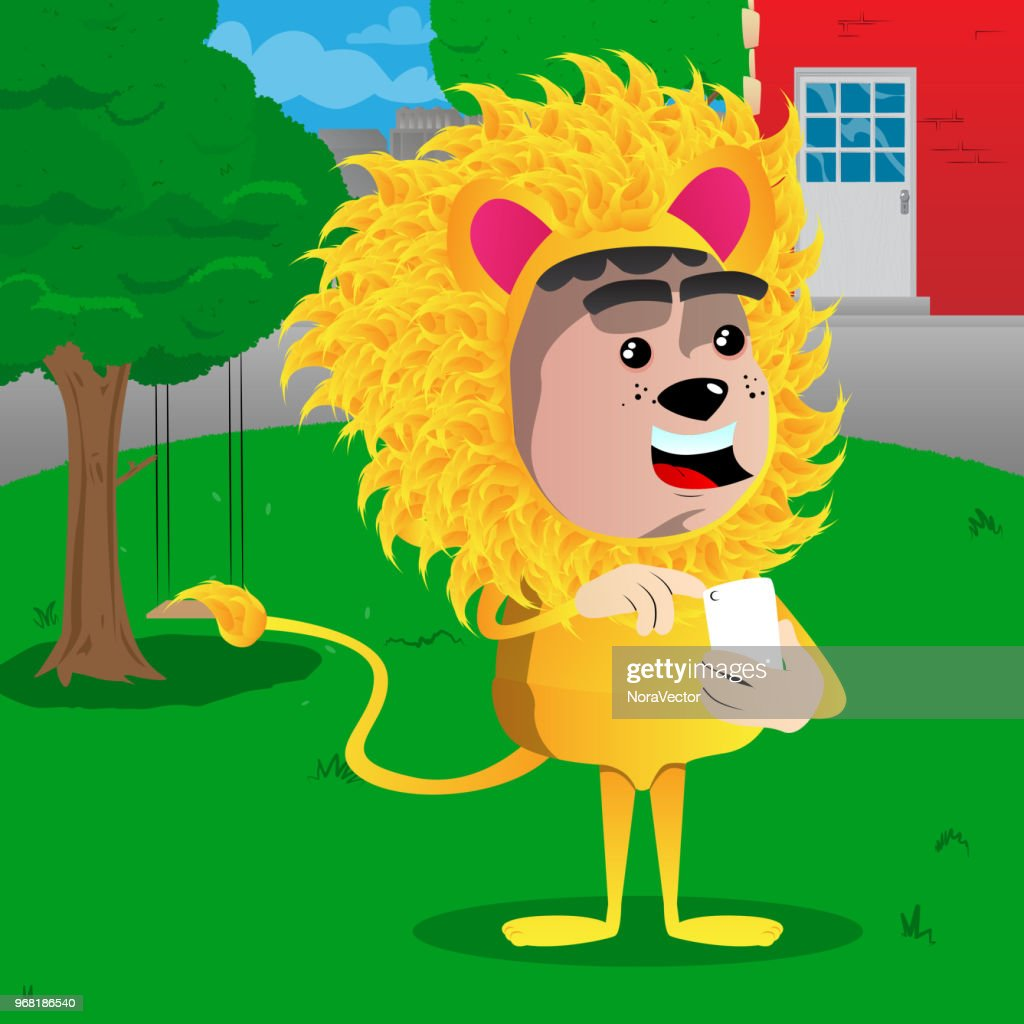 Boy dressed as lion using a mobile phone.