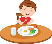 Boy eating meal