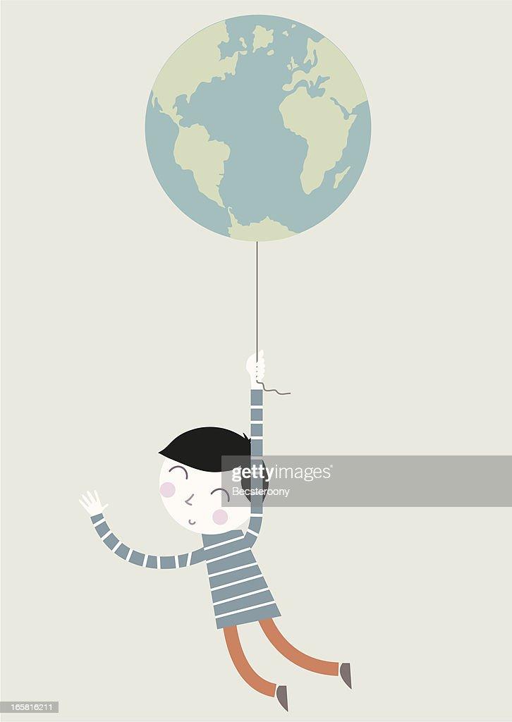 Boy holding earth balloon