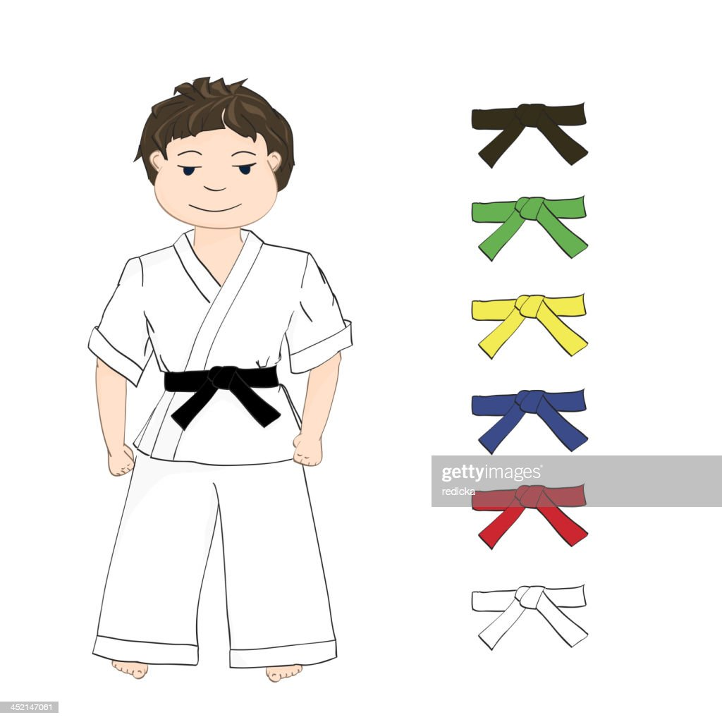 Boy in a martial arts outfit with a black belt