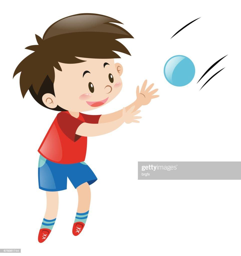 Boy in red shirt catching blue ball