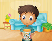 boy inside the house with a jar of candies