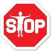 Boy making a t-shape with body on a stop sign