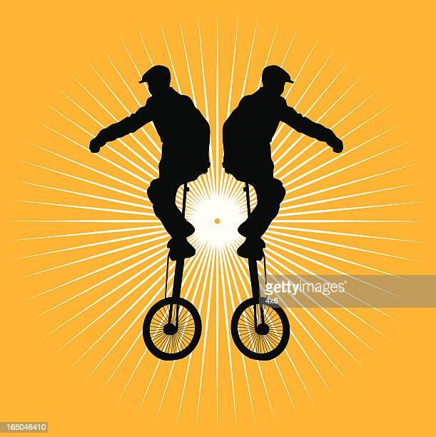boy on unicycle - unicycle stock illustrations, clip art, cartoons, & icons