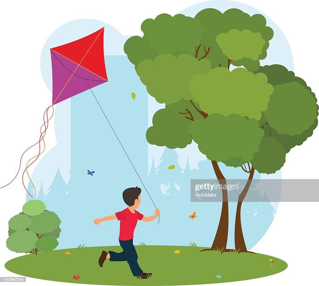 Boy playing kite.