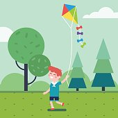 Boy playing with kite in the park